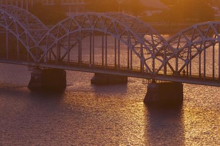 Railway Bridge in Riga at sunset. Riga, Latvia. 版權商用圖片