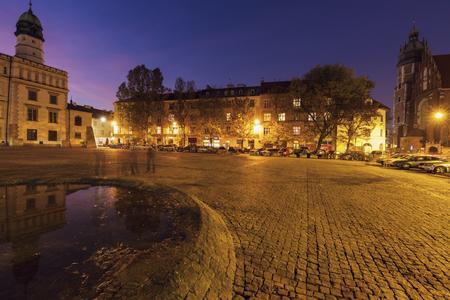 Corpus Christi Basilica and old city hall on Wolnica Square in Krakow. Krakow, Malopolskie, Poland.