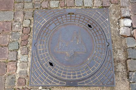 Manhole in the center of old Riga. Riga, Latvia 版權商用圖片