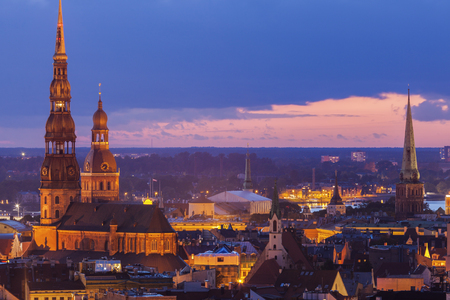 St. Peter Church and Riga Cathedral at sunset. Riga, Latvia