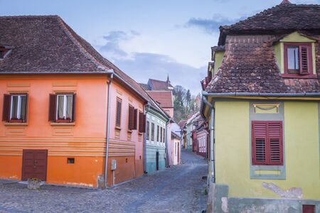 Colorful streets of Sighisoara. Sighisoara, Mures County, Romania. Imagens