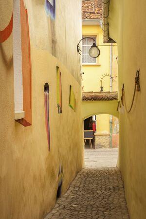 Strada Sforii - the narrowest street in Brasov. Brasov, Brasov County, Romania.