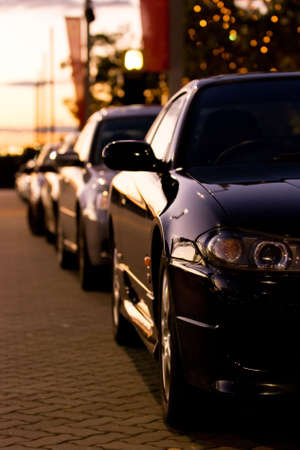 parked: Row of parked cars at sunset