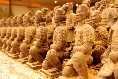 terracotta: Miniature terracotta warriors on display in a factory in Xian, China.