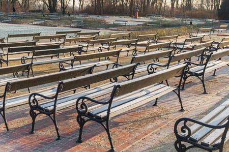 fryderyk chopin: Warsaw, Poland Famous Ujazdow park and lot of bench (Park Ujazdowski)