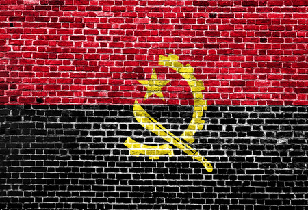 Flag of Angola painted on brick wall, background texture Stock Photo