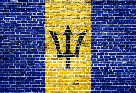 Flag of Barbados painted on brick wall, background texture