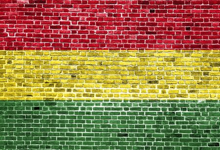 Flag of Bolivia painted on brick wall, background texture Stock Photo
