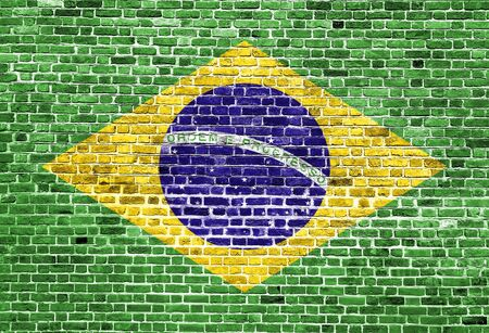 Flag of Brasil painted on brick wall, background texture