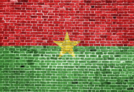 Flag of Burkina Faso painted on brick wall, background texture