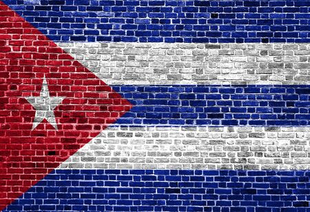 Flag of Cuba painted on brick wall, background texture