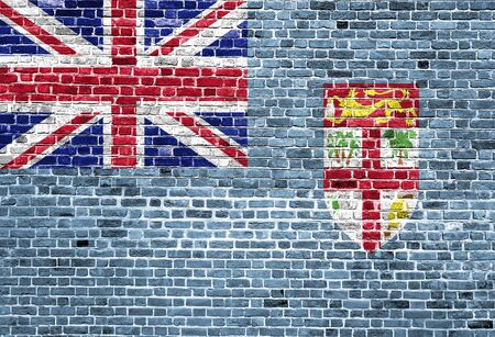 Flag of Fiji painted on brick wall, background texture Stock Photo