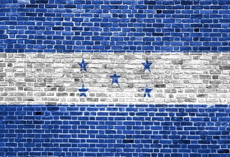 Flag of Honduras painted on brick wall, background texture