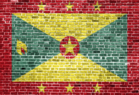 grenada: Flag of Grenada painted on brick wall, background texture Stock Photo