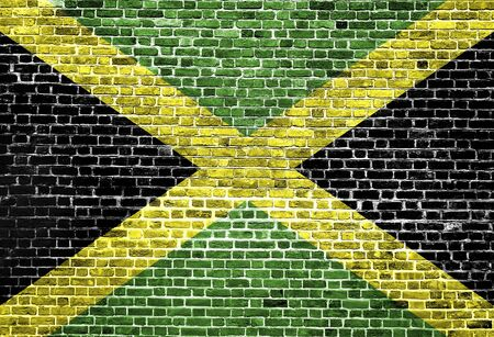 Flag of Jamaica painted on brick wall, background texture