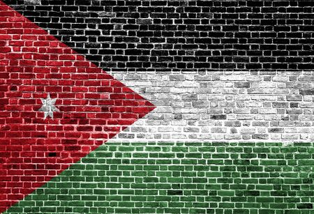 Flag of Jordan painted on brick wall, background texture Stock Photo