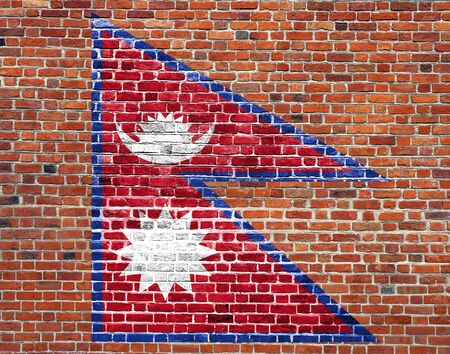 Flag of Nepal painted on brick wall, background texture Stock Photo