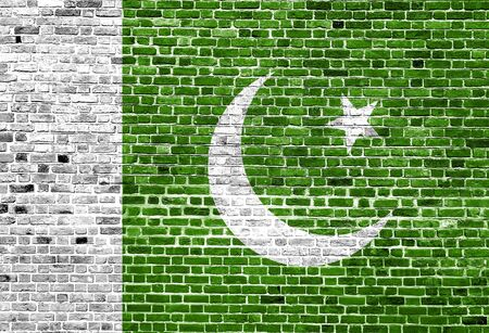Flag of Pakistan painted on brick wall, background texture