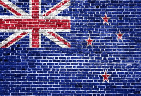 Flag of New Zealand painted on brick wall, background texture
