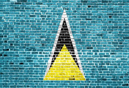 Flag of Saint Lucia painted on brick wall, background texture Stock Photo