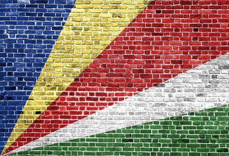 Flag of Seychelles painted on brick wall, background texture Stock Photo