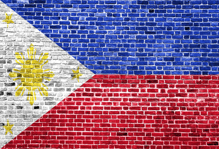Flag of Phillipines painted on brick wall, background texture