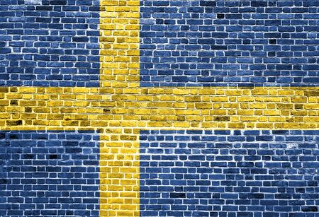 Flag of Sweden painted on brick wall, background texture Stock Photo