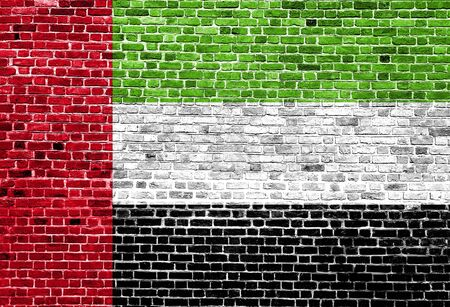 Flag of United Arab Emirates painted on brick wall, background texture