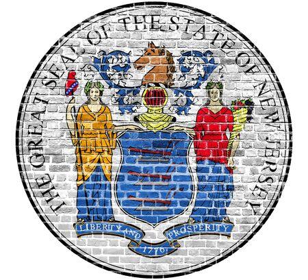 New Jersey Seal Americká vlajka namalovaná na staré vinobraní cihlové zdi Reklamní fotografie