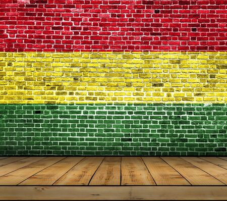 Bolivia flag painted on brick wall with wooden floor Stock Photo