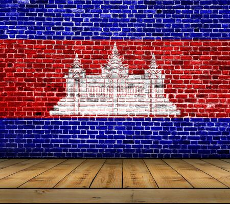 Cambodia flag painted on brick wall with wooden floor Stock Photo