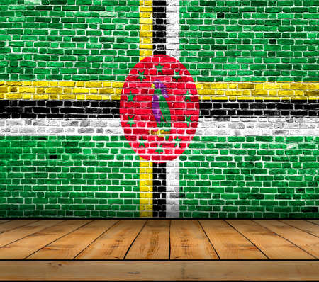 Dominica flag painted on brick wall with wooden floor