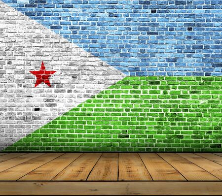 Djibouti flag painted on brick wall with wooden floor Stock Photo