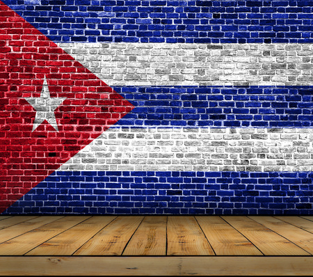 Cuba flag painted on brick wall with wooden floor Stock Photo