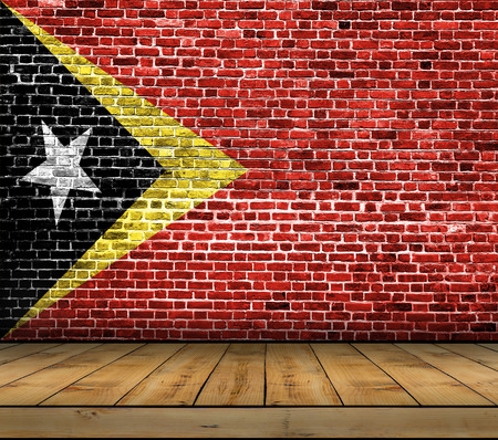 Timor flag painted on brick wall with wooden floor Stock Photo