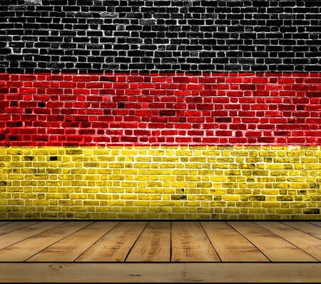 Germany flag painted on brick wall with wooden floor