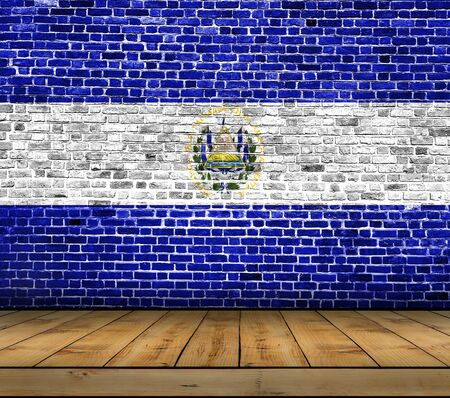 El Salvador flag painted on brick wall with wooden floor