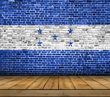 Honduras flag painted on brick wall with wooden floor Stock Photo