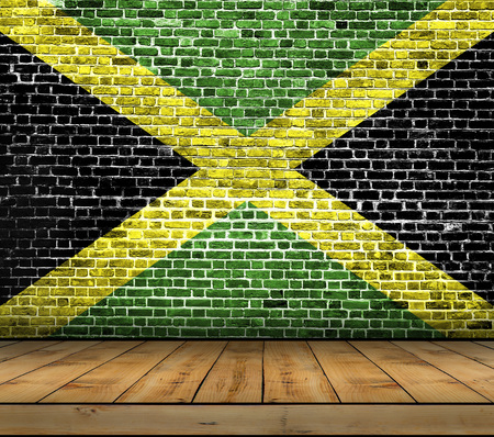 jamaican: Jamaica flag painted on brick wall with wooden floor