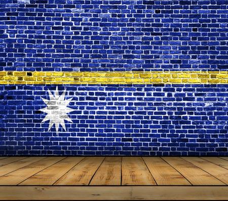 Nauru flag painted on brick wall with wooden floor Stock Photo