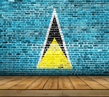 Saint Lucia flag painted on brick wall with wooden floor