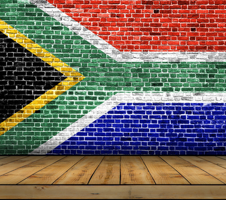 South Africa flag painted on brick wall with wooden floor