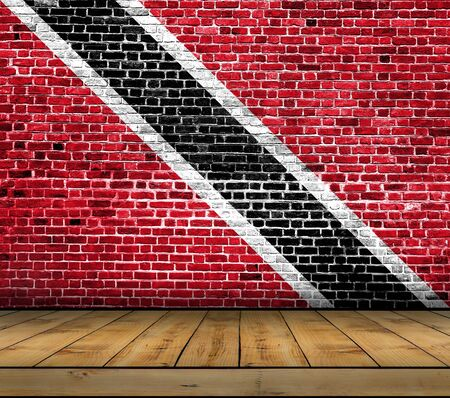 Trinidad and Tobago flag painted on brick wall with wooden floor