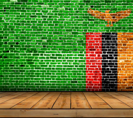 Zambia flag painted on brick wall with wooden floor