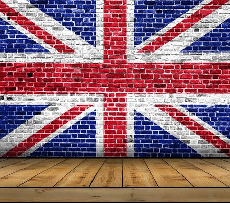 UK flag painted on brick wall with wooden floor