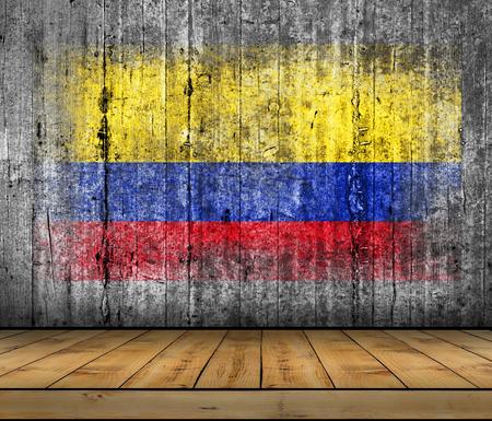 identidad cultural: Columbia bandera pintada sobre fondo textura gris hormigón con piso de madera