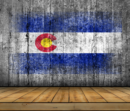 Colorado flag painted on background texture gray concrete with wooden floor