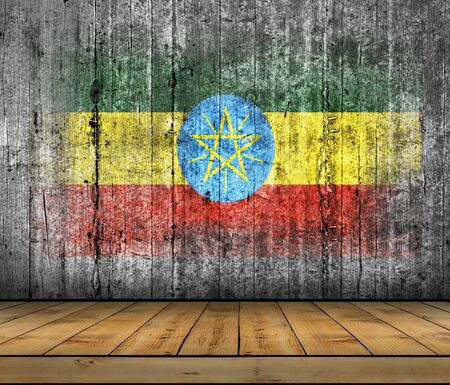 abstract paintings: Ethiopia flag painted on background texture gray concrete with wooden floor