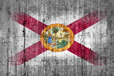 u.s. flag: FLorida flag painted on background texture gray concrete