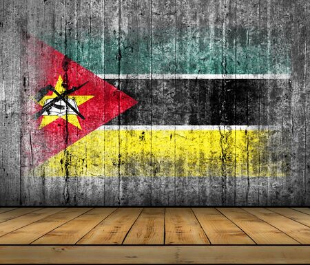 Mozambique flag painted on background texture gray concrete with wooden floor Stock Photo